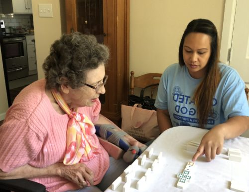Our Compassionate Caregiver entertaining our client with table games